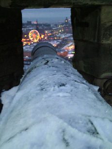 Edinburgh Castle view from a cannon of the Winter Wonderland and markets
